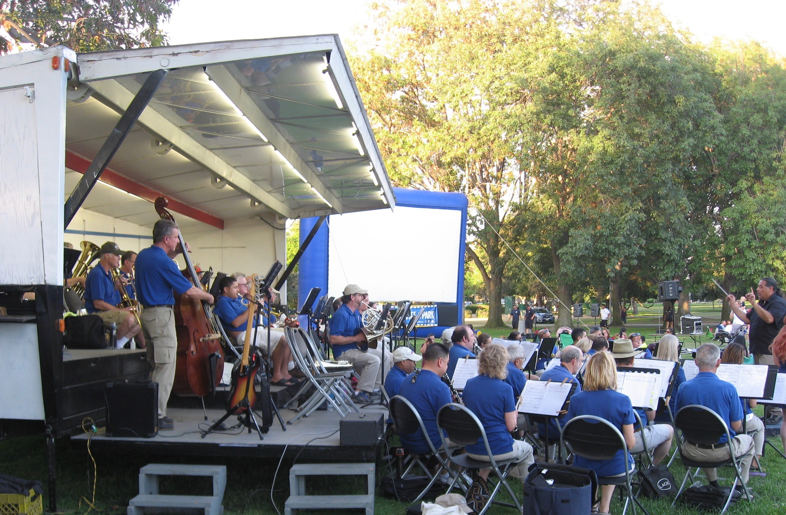 Performing for a Movie Night audience at Stearns-Champoins Park